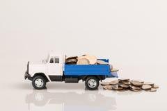 Camion del giocattolo con le monete Fotografia Stock Libera da Diritti