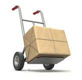 Camion di mano con il pacchetto dell'alberino Fotografie Stock