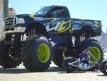 Camion di mostro sulla spiaggia Immagini Stock
