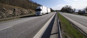 Camion e strada principale panoramici Immagine Stock