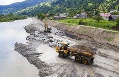 Camion ed escavatore su un cantiere Fotografia Stock Libera da Diritti
