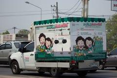 Camion pick-up et récipient pour le service de distribution de lotus de Tesco Photographie stock