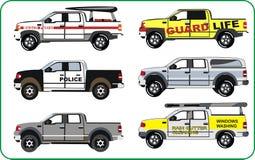 Camiones de la policía, patrulla de la playa Foto de archivo libre de regalías
