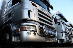3 camiones de plata Imágenes de archivo libres de regalías