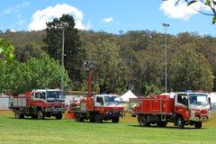 Camiones del departamento de bomberos alineados Fotografía de archivo libre de regalías