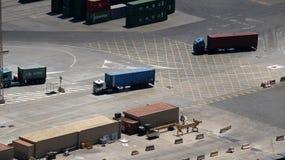 Camiones del envase en un puerto Fotografía de archivo libre de regalías