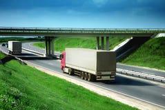 Camiones en un camino Imagen de archivo libre de regalías