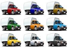 Camionnettes de livraison de dessin animé réglées Photographie stock libre de droits