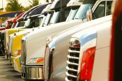 Camions alignés Photographie stock libre de droits