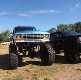 Camions avec de grandes roues Photographie stock libre de droits
