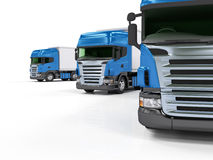 Camions bleus lourds d'isolement sur le fond blanc Photo stock