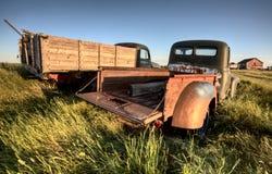Camions de ferme de cru Images stock