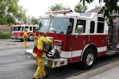 Camions de pompiers et chasseurs d'incendie Photographie stock