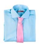 Camisa azul con un lazo rosado Foto de archivo
