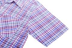 Camisa de algodón en el fondo blanco Fotografía de archivo