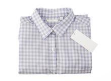 Camisa de tela escocesa azul con la etiqueta Fotos de archivo