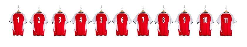 Camisa roja del fútbol en fila Foto de archivo libre de regalías