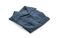 camisa t-shirt dobrado no branco imagens de stock