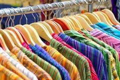 Camisas colgadas Foto de archivo libre de regalías