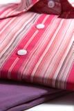Camisas de alineada de las mujeres coloridas Imágenes de archivo libres de regalías