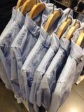 Camisas em um gancho Fotos de Stock