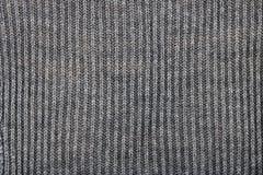 A camiseta é amarrada com linhas cinzentas grossas das linhas da sutura Imagens de Stock