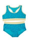 Camiseta azul y amarilla y bragas fijadas Imagen de archivo libre de regalías