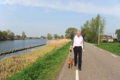 Camminando il cane Fotografia Stock