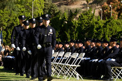 Camminare per ottenere il documento - LAPD Immagini Stock