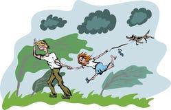 Camminata della famiglia in giorno ventoso Immagine Stock Libera da Diritti