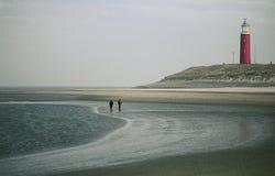 Camminata rossa di marea bassa del faro Immagine Stock Libera da Diritti