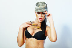Camo girl in hat Stock Photo