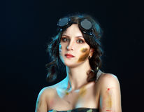 Camo girl. Soldier woman wear steampunk googles fantasy concept over black background stock photos