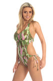 Camo Monokini. Blond swim wear model in a camo pattern Monokini royalty free stock photos