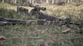 Camo painted crossbow on the grass. Camera moving up stock video