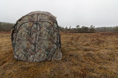 Camoflage tent at the grouse lek. Early morning in early April. Springtime Stock Photo