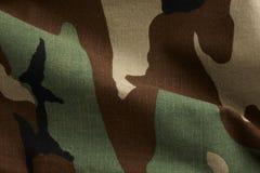Camoflague. Macro shot of camoflague material fills the frame stock photography