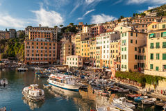 CAMOGLI, ITALY - AUGUST 7 2016: Small harbor in the town of Camogli Liguria, northern Italy during the golden hour in a summer a Stock Photos