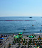 CAMOGLI, ITALY - JUNE 13, 2017: tourists on the beach with umbrellas and deck chairs, Camogli, Liguria, Italy Royalty Free Stock Photography
