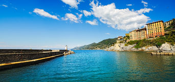 Camogli marina harbor entrance and lighthouse. Ligury, Italy Stock Image