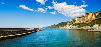 Camogli marina harbor entrance and lighthouse. Ligury, Italy Stock Image