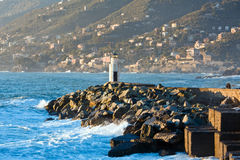 Camogli's Lighthouse. The white lighthouse at the entrance to the port of Camogli royalty free stock photography