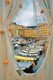Camogli sea Port with yellow fishing nets Stock Photos
