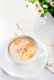 Camomile hebal tea in a white cup with Stock Photography