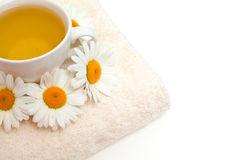 Camomile tea on bath towel Royalty Free Stock Photo