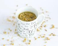 Camomile tea on white. Background stock image