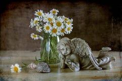 Camomiles en engel Royalty-vrije Stock Fotografie