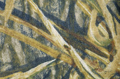 Camouflage. Fund created by the color design of a camouflage material Royalty Free Stock Photo