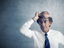 Camouflage. Business men disguises himself with another face Royalty Free Stock Images
