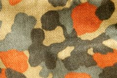 Camouflage. The fabric military camouflage background Royalty Free Stock Photography